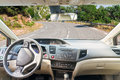 Car windscreen with road country view inside out Stock Photo