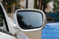 Car wing mirror a photo taken on the side of a light coloured luxury Stock Image