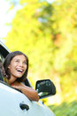 Car woman road trip looking out window smiling happy beautiful multicultural asian caucasian woman Stock Image