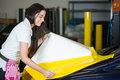 Car wrapper preparing foil to wrap a vehicle yellow Stock Images