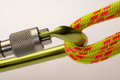 Carabiner and climbing rope closeup of a high quality attached to with a plain background Stock Photography