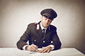Carabiniere writing something on a paper Royalty Free Stock Photo