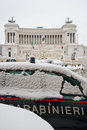 Carabinieri victor emmanuel snow a police car covered in in front of the unification monument in rome italy Royalty Free Stock Photos