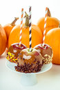 Caramel apples with candy for halloween three orange pumpkins in a buffet Royalty Free Stock Image