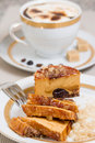 Caramel cake and coffee with cream on background slices coffe Stock Photos