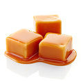 Caramel candies and caramel sauce Royalty Free Stock Photo