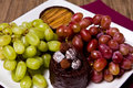 Caramel, Chocolate and Grapes Stock Photography