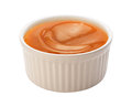 Caramel syrup in a ramekin creamy white this sauce can be used for dipping or as an ingredient the image is cut out isolated on Stock Photos