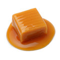 Caramel toffee and sauce isolated on a white background Stock Photos