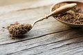 Caraway seeds in spoon on wooden table Royalty Free Stock Photos