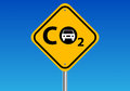 Carbon emissions a traffic sign with the symbol co for and car symbol Stock Photography