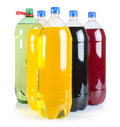 Carbonated drinks in plastic bottles multicolored studio shot Stock Image