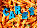 Carbs carbohydrates nutrition concept as a plate of cooked pasta with the word for complex sugar embedded in the starch rich food Stock Photos