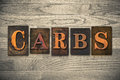 Carbs wooden letterpress theme the word written in vintage ink stained type on a wood grained background Stock Photos