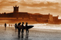 Carcavelos surfers silhouette of in the beach looking at the sea at sunset Stock Photography