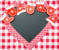 Card blank in heart shape with christmas tree decorations on red gingham tablecloth winter holidays concept copy space for your Stock Photography
