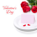 Card for congratulation on a plate and roses for valentine s day isolated white Royalty Free Stock Photography