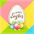 Card with Painted Easter Eggs in Grass on Colorful Background