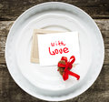 Card with Message With Love on White Plates Stock Image