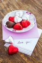 Card with message love you and chocolate candy in a letter Stock Photo