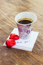 Card with message love you cup of coffee and chocolate candy in a letter Stock Image