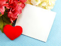 Card and red heart on blue polka dot background