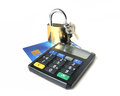 Card security with tan generator black and gold colored padlock keys on top of a expired credit Stock Images