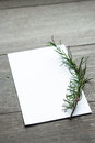Card for someone special decorated with rosemary on wood background Stock Image