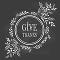 Card for thanksgiving day on the blackboard with floral design Stock Photo