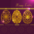The Card with three Golden Glowing Easter eggs with Mandala pattern with Highlights on it. Abstract eggs. Greeting Happy Easter C