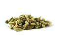 Cardamom pile of whole on white background Stock Image