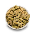 Cardamom whole in a plate isolated on a white background Royalty Free Stock Photo