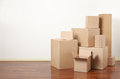 Cardboard boxes in apartment interior moving day Royalty Free Stock Images