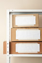Cardboard boxes with blank labels moving storage concept Royalty Free Stock Photos
