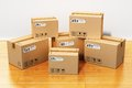 Cardboard boxes in new house construction industry housing habitation and real estate business concept group of stacked on wooden Stock Photo