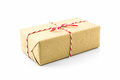 Cardboard carton wrapped with brown paper, tied with string. Royalty Free Stock Photo