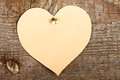 Cardboard heart beige attached to old wooden wall Stock Photo