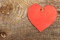 Cardboard heart red attached to old wooden wall Royalty Free Stock Photography