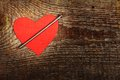 Cardboard heart red with big nail on wooden background Royalty Free Stock Images
