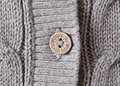 Cardigan button close up of a on a wool Royalty Free Stock Photo