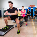 Cardio step dance squat group at fitness gym Royalty Free Stock Photo