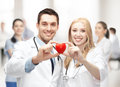 Cardiologists with heart healthcare and medical concept Royalty Free Stock Photography