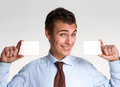 Cards man young businessman holding two white Royalty Free Stock Photography
