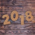 Cardstock Numbers 2018 Happy New Year Sign over table. 3d Render Royalty Free Stock Photo