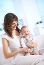 Care of baby portrait happy women holding her small son Stock Photo