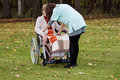 Care of disabled young nurse caring elder woman Royalty Free Stock Photos