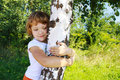 Care for nature - little girl embrace a tree Stock Photography