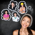 Career choice options student thinking of future education young asian woman contemplating smiling looking up at Stock Image