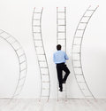Career choices concept and opportunities businessman climbing the right ladder Royalty Free Stock Photo