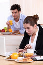 Career woman eating breakfast women while working Stock Images